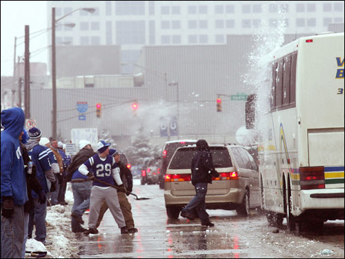 A bus full of Patriots fans sat outside the RCA Dome getting pummeled by snow balls as it arrived at the RCA Dome.