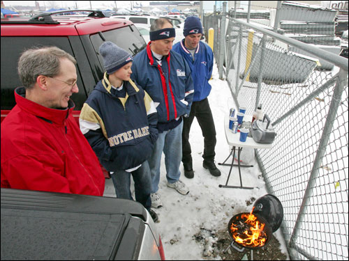 (Left to right): Patriots fans Ed Cruz of York, Maine, Alex Boardman and Mark Boardman of Columbus, Ohio and Scott Plaisted of York, Maine tailgated behind their car outside the RCA Dome.