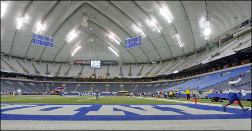 Colts wide reciever Reggie Wayne (right) hauled in a pass while loosening up at the RCA Dome.
