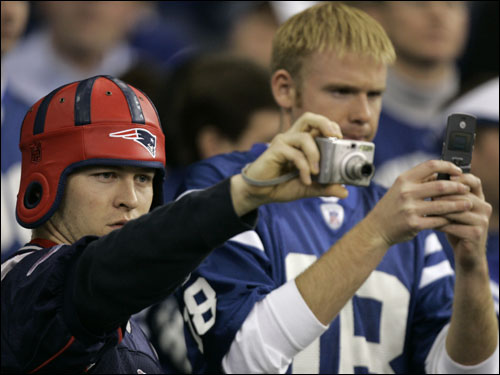 Patriots and Colts fans took photos of players during warmups.