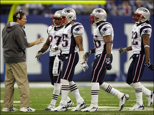 Bill Belichick talked with his defense during a timeout in the first quarter.