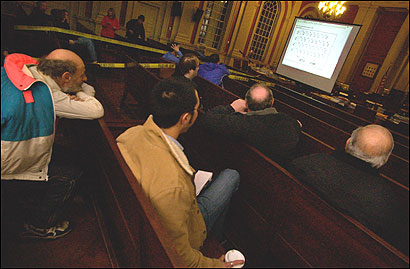 People gathered in the Aldermanic Chambers of Newton City Hall yesterday to watch the results of a special election.