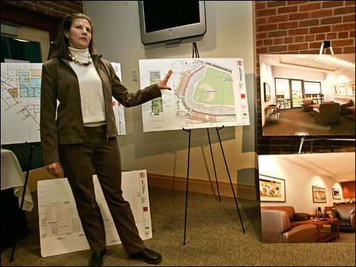 Janet Marie Smith, Red Sox senior vice president/planning and development ,shows off drawings and photographs of ongoing improvements to Fenway Park as part of the improvements expected to be completed by Opening Day.