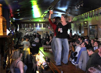 Jessica Crowley of Sanford, Maine leads a bartop conga line at The Iguana. Dancing on the bar is a common weekend occurrence at this night spot in the Old Port District in Portland, Maine.