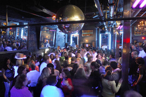 The dance floor is packed at Liquid Blue in the Old Port District in Portland, Maine as midnight approaches on a Saturday night.