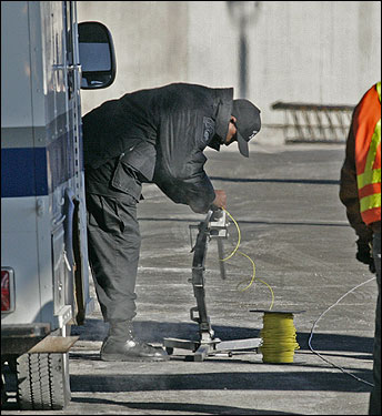 Investigators do not know how the object got onto the girder and were trying to determine if it was a hoax or something else entirely. At left, a bomb squad member prepared a water cannon to destroy the suspicious object.
