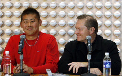 Matsuzaka was dressed casually in a red Nike T-shirt and Nike sneakers with red laces -- Scott Boras just completed a multimillion-dollar endorsement deal with the athletic shoe manufacturer.