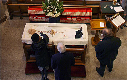 A woman prayed at the casket before the Rev. Robert F. Drinan's funeral Mass yesterday in the Church of St. Ignatius of Loyola.