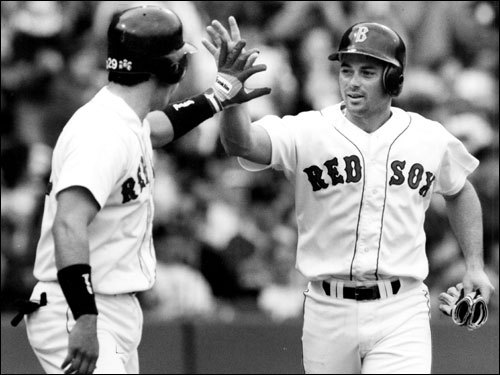 Jody Reed Reed went to the postseason twice during his six-year run in Boston and hit over .280 for five consecutive seasons. In 1990, Reed led the AL in doubles with 45 and hit more than 40 doubles in 1989 and 1991. In this 1992 photo, Reed gives a high-five to Sox outfielder Phil Plantier. ( Reed's stats and facts )