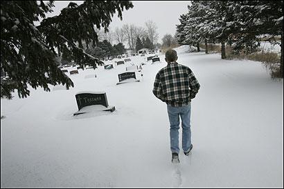James Schulze walked to the grave of his son, Jonathan, an Iraq war veteran.