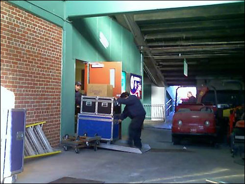 Equipment was wheeled out to the truck from the bowels of Fenway Park.