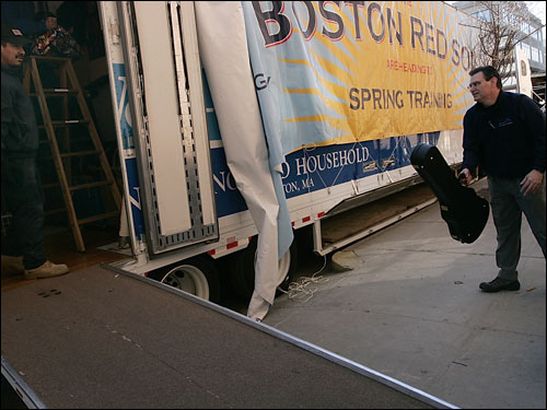Kevin Carson loaded Theo Epstein's guitar onto the moving van.