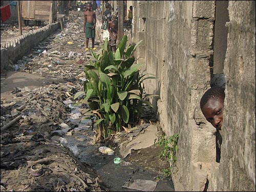 "Garbage lines the streets in the Ajegunle slum in Lagos, Nigeria, where an estimated 3 million live. Local residents call it the ""Jungle.''"