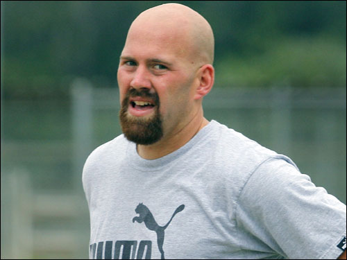 Youkilis is shown taking a breather after doing some sprints.