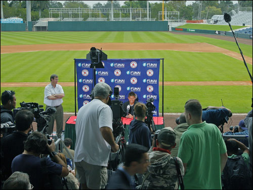 Matsuzaka was seated at a table located on top of the third base dugout.