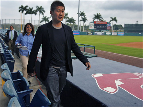 Here, he arrived for the event. Walking behind him is Red Sox employee Sachiyo Sekiguchi, who served as his translator.