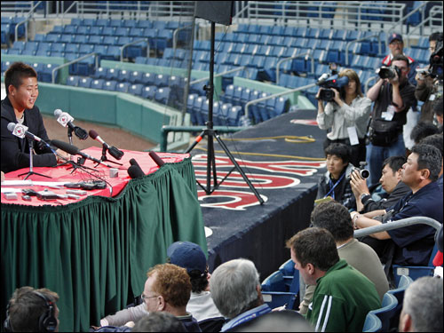 Matsuzaka addressed the massive press contingent.