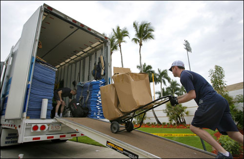 Following the two day drive from chilly Boston, the Red Sox equipment truck was parked under some palm trees early Thursday morning outside the team clubhouse at City of Palms Park. Clubhouse attendant John Coyne is seen moving equipment.