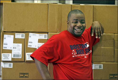Home clubhouse attendant Edward 'Pookie' Jackson had a laugh while leaning against a large stack of boxed baseballs inside the clubhouse.