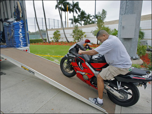 Visiting clubhouse attendant Kenyatta Gomez rolled his own personal motorcycle that made the trip south down the ramp.