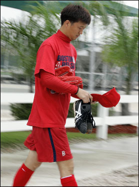 Red Sox pitcher Hideki Okajima walked to the field at spring training camp in Fort Myers.
