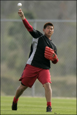 Matsuzaka let go of a throw in the outfield at the Sox minor league complex.