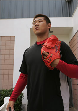 Armed with a Nike glove, Daisuke Matsuzaka took the field for yet another highly scrutinized workout.