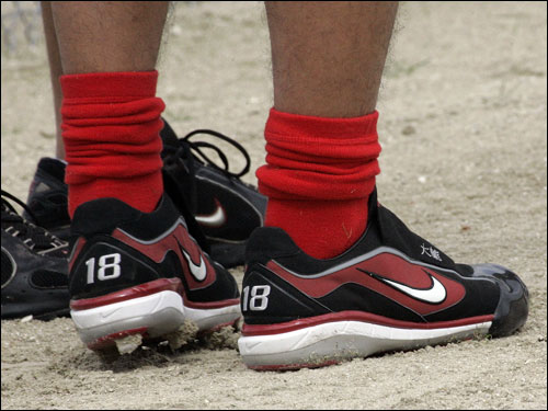 Matsuzaka wore red socks and cleats that sported his number.