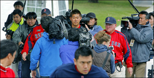 Matsuzaka was surrounded as he made his way from a field to the clubhouse after he worked out this morning.
