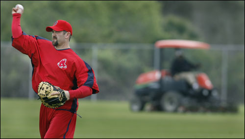 Red Sox captain Jason Varitek arrived in camp Friday afternoon after all the workouts were finished, so when he went out to play catch, the lawn on the field was being mowed.