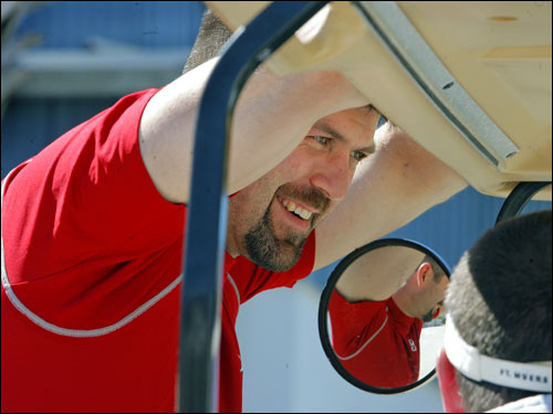 Red Sox catcher Jason Varitek was reflected in a mirror while talking to a team staff member.