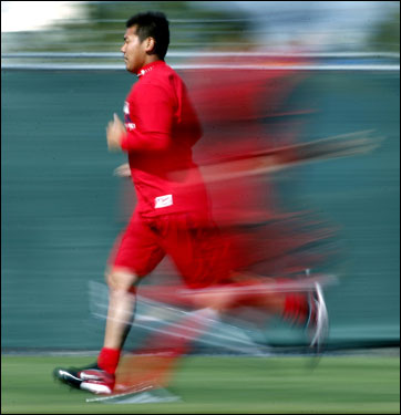 Red Sox pitcher Daisuke Matsuzaka and a teammate behind him were a red blur as they ran.