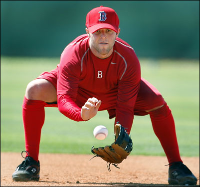 Second baseman Dustin Pedroia was out taking some ground balls hit by former second baseman Luis Alicea, who is the team's new first base coach this season.