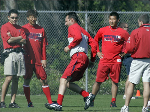 Tim Wakefield (center) worked out as his teammates watched.