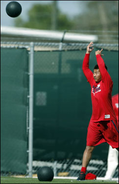 Daisuke Matsuzaka threw a medicine ball during team conditioning.