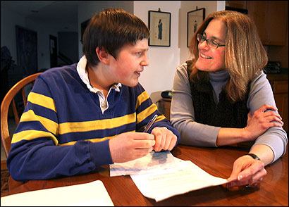 Jennie DunKley of Easton helped her son Sam, 13, with schoolwork. Sam has Asperger's disorder and attends a private school in Rhode Island.