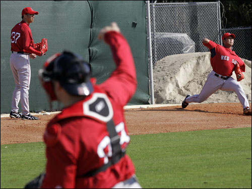 Matsuzaka (right) threw with his teammate Hideki Okajima in the bullpen.