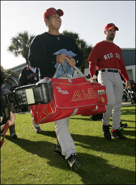 Matsuzaka and Varitek, with the pitcher carrying the catcher's bag, took the field for the first full day of workouts.