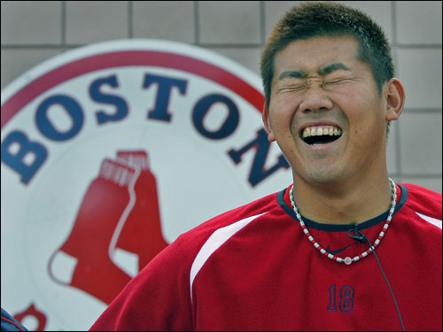 Matsuzaka,during a post practice press availability, cracked up when asked a question about why he carried Jason Varitek's equipment bag onto the field for him.
