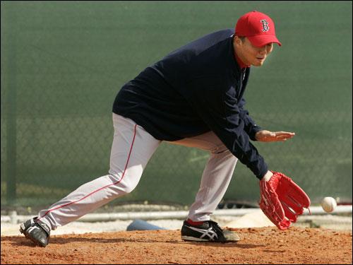 Sox reliever Hideki Okajima took some ground balls.