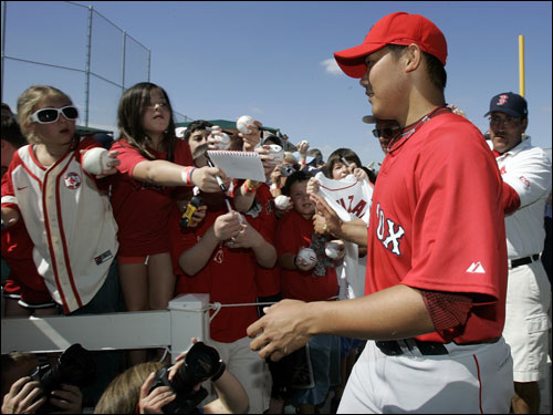 Matsuzaka acknowledged fans on his way to spring training workouts.