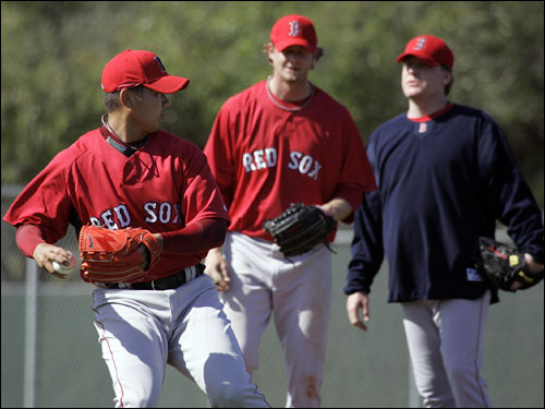 Dice-K (left) warmed up as Kyle Snyder (center) and Curt Schilling looked on.