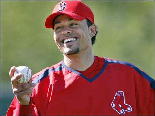 Red Sox center fielder Coco Crisp arrived in camp today and seemed happy to be there.