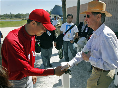 Red Sox owner John Henry (right) shook hands with Japanese pitcher Hideki Okajima (left) who bowed as he did it.