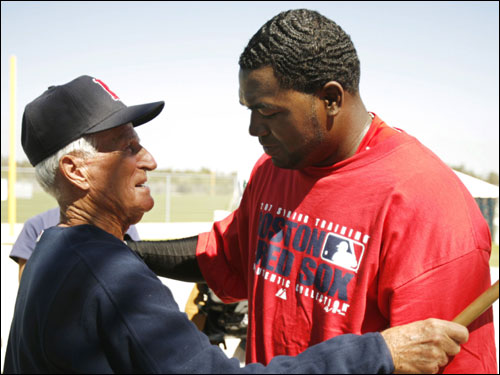 David Ortiz (right) greets Red Sox legend Johnny Pesky at the team's spring training facility Wednesday.