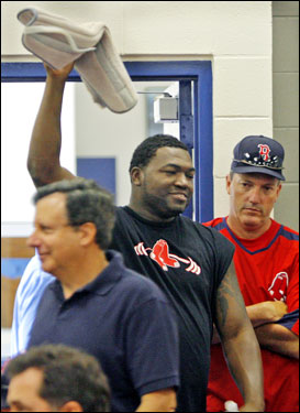 Before Ortiz entered the meeting room, he took off the neck brace and waved it around.
