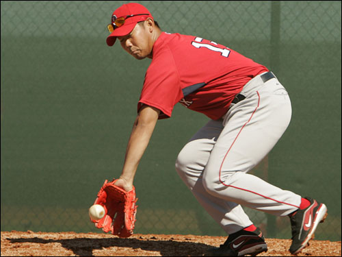 Daisuke Matsuzaka took ground balls during a drill.