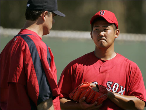 Matsuzaka (right) talked with pitching coach John Farrell.