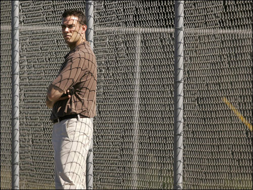 Theo Epstein took in the action from a fence next to the field.