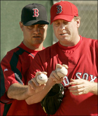 Schilling (right) talked with pitching coach John Farrell.